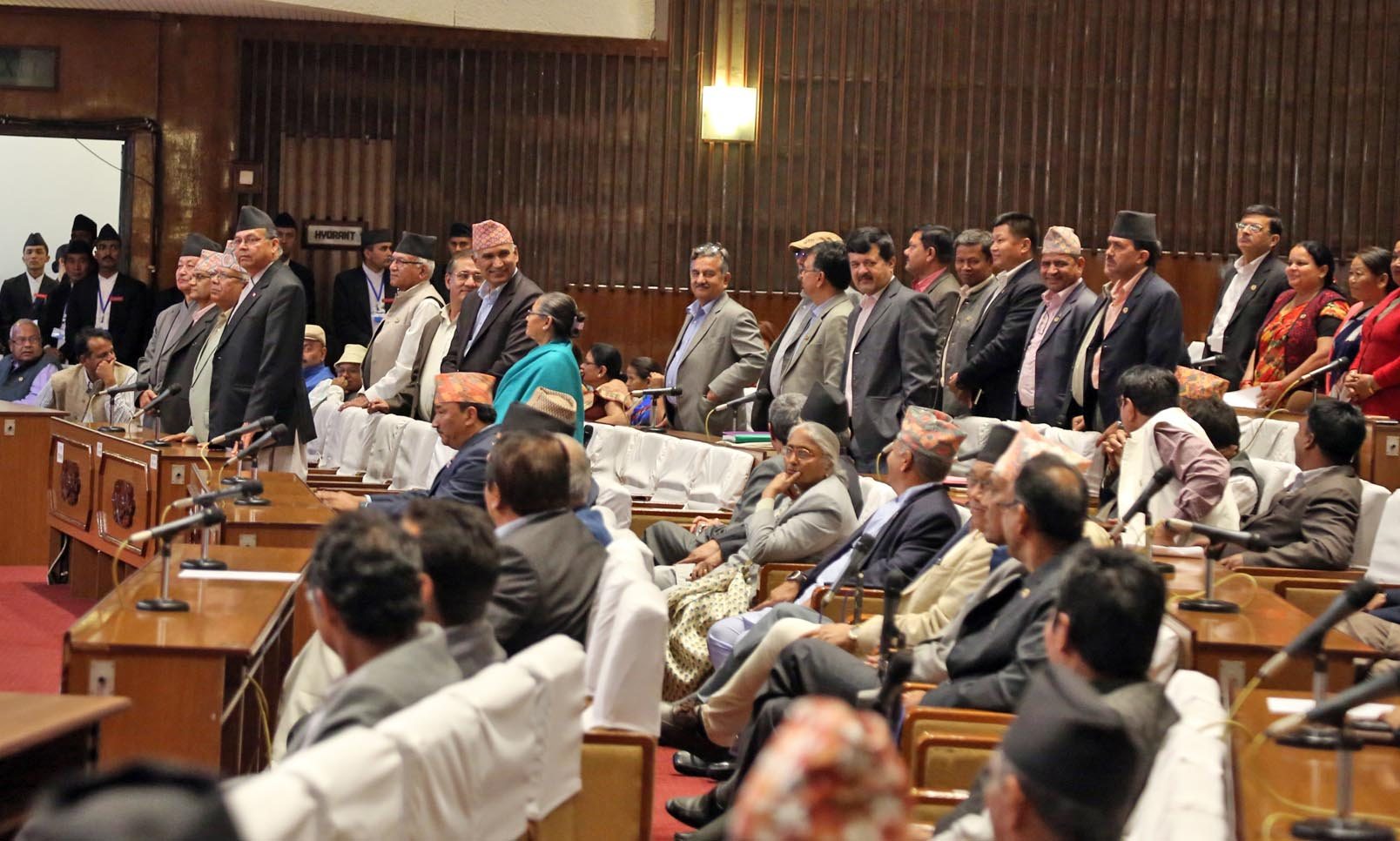 CPN-UML lawmakers stand at the Parliament to protest the government decision to increase the local levels before the elections. Photo: RSS