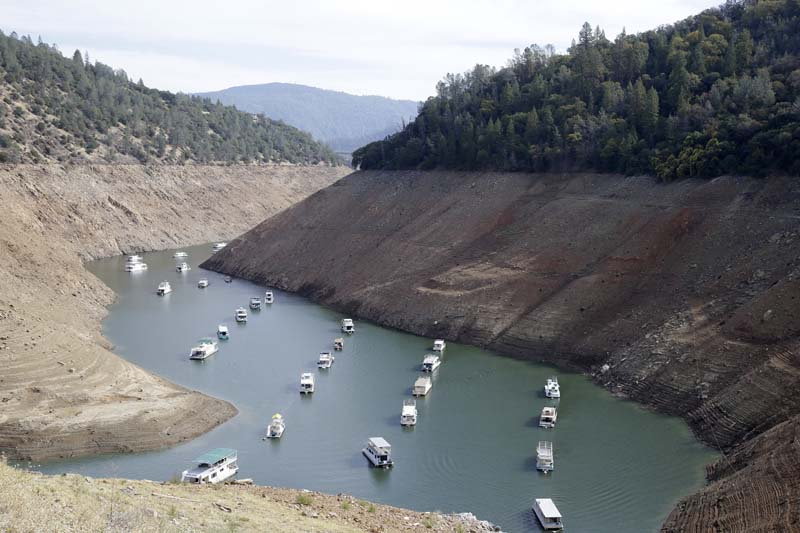 Houseboats sit in the drought lowered waters of Oroville Lake, near Oroville, California, on Thursday, October 30, 2014. Photo: AP/File