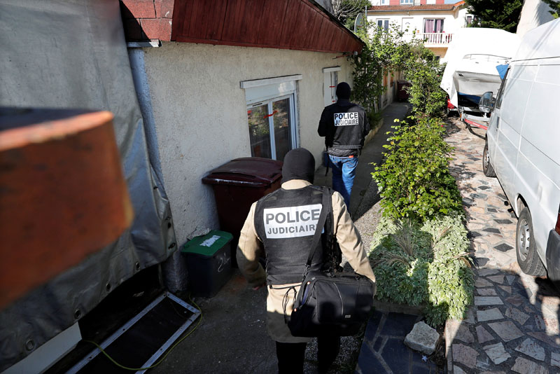 French police arrive at the house of the gunman killed in a shootout with police on the Champs Elysees Avenue, in the Paris suburb of Chelles, France, on April 21, 2017. Photo: Reuters