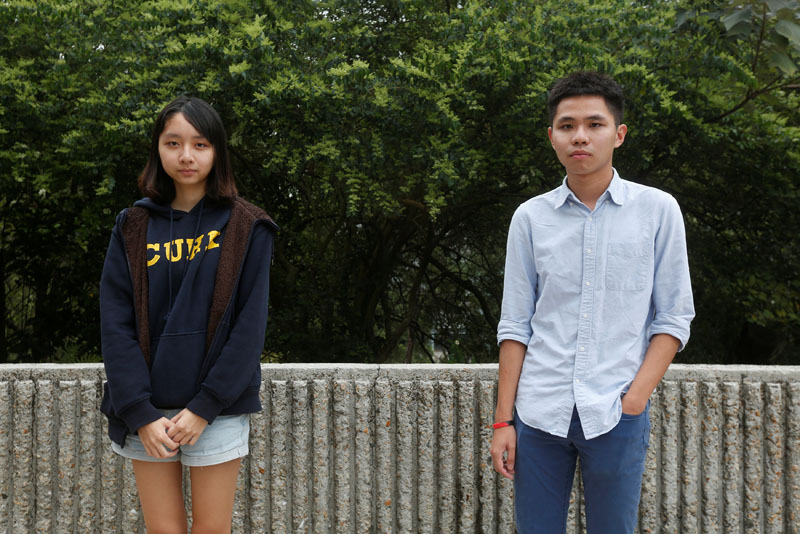 Chinese University Student Union External Vice President Cheryl Chu (left), 19, and External Secretary Thomas Lee, 24, pose inside the university campus in Hong Kong, China on March 30, 2017. Photo: Reuters