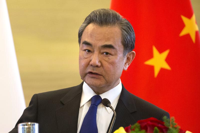 Chinese Foreign Minister Wang Yi speaks during a joint press conference with his French counterpart Jean-Marc Ayrault at the Ministry of Foreign Affairs in Beijing, Friday, April 14, 2017. Photo: AP