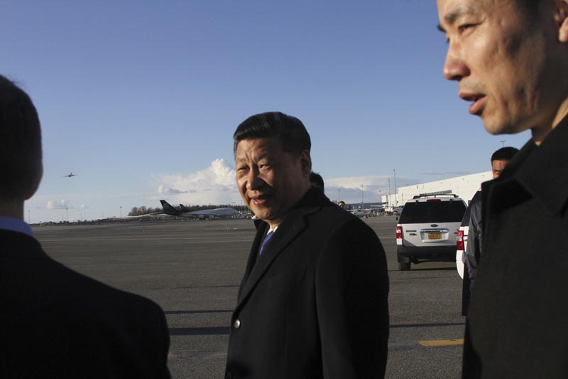 Chinese President Xi Jinping, center, smiles after getting off his plane for a refueling stop in Anchorage, Alaska, on Friday, April 7, 2017. Xi planned a little sightseeing and a meeting and dinner with Alaska Gov. Bill Walker after meeting earlier in the day with President Donald Trump in Florida. Photo: AP