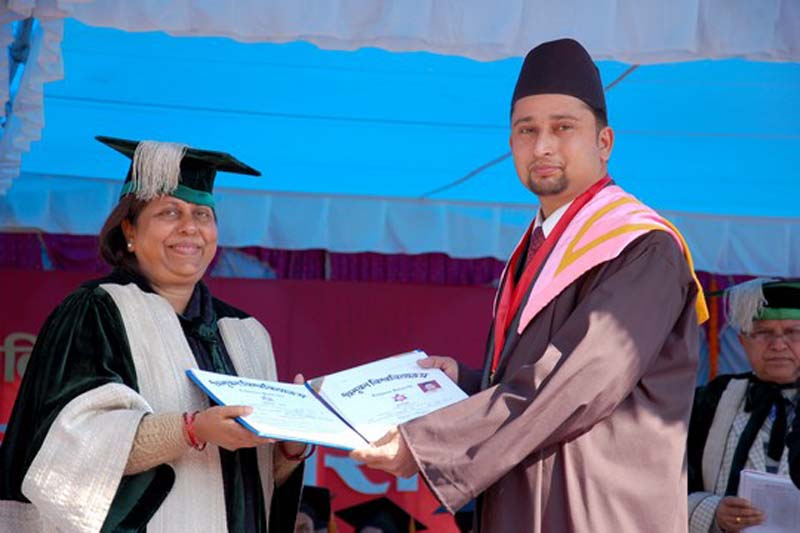 Gokul Pokhrel receiving certificate from the then Education Minister Chitra Lekha Yadav in 2015