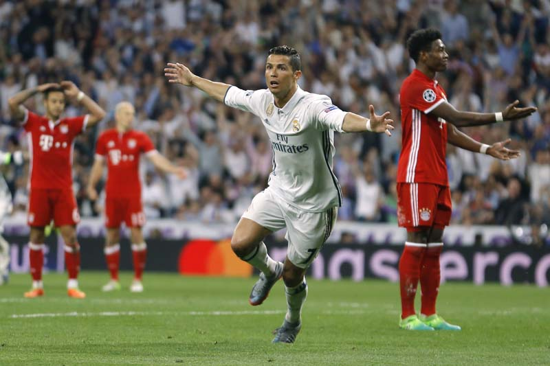 Real Madrid's Cristiano Ronaldo (center), celebrates after scoring as Bayern players react during the Champions League quarterfinal second leg soccer match between Real Madrid and Bayern Munich at Santiago Bernabeu stadium in Madrid, Spain, on Tuesday April 18, 2017. Photo: AP
