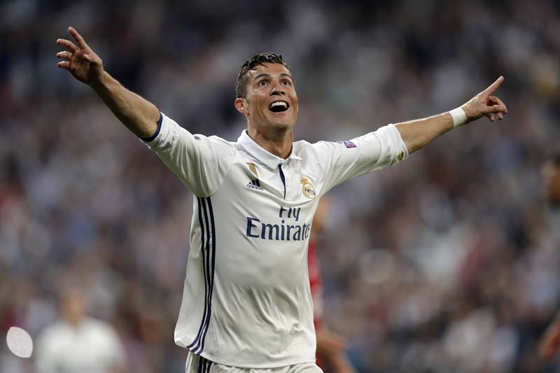 Real Madrid's Cristiano Ronaldo celebrates after scoring his side's third goal during the Champions League quarterfinal second leg soccer match between Real Madrid and Bayern Munich at Santiago Bernabeu stadium in Madrid, Spain, on Tuesday April 18, 2017. Photo: AP