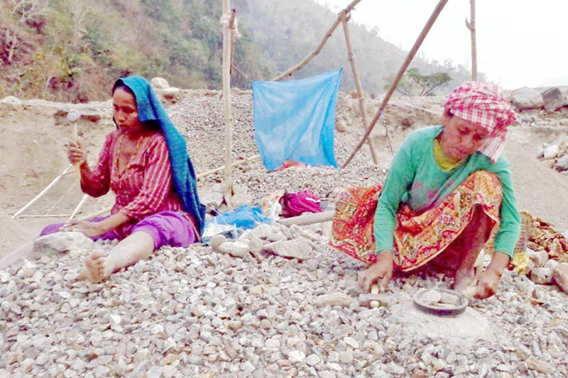 Women are seen crushing stones at a river bank bank in Ilam district, on Friday, April 28, 2017. Photo: RSS