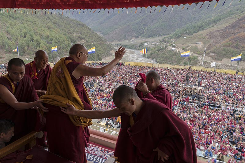 Tibetan spiritual leader the Dalai Lama, waves to supporters during teachings after consecrating the Thupsung Dhargyeling Monastery in Dirang, Arunachal Pradesh, India, Thursday, April 6, 2017. The Dalai Lama consecrated the Buddhist monastery on Thursday in India's remote northeast, amid Chinese warnings that the exiled Tibetan spiritual leader's visit to the disputed border region would damage bilateral relations with India. Photo: AP