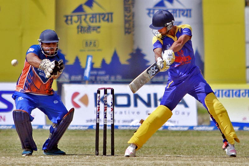 A batsman plays a cut shot as wicketkeeper looks on during the Dhangadhi Premier League, in Dhangadhi on Sunday, April 16, 2017. Photo: Tekendra Deuba