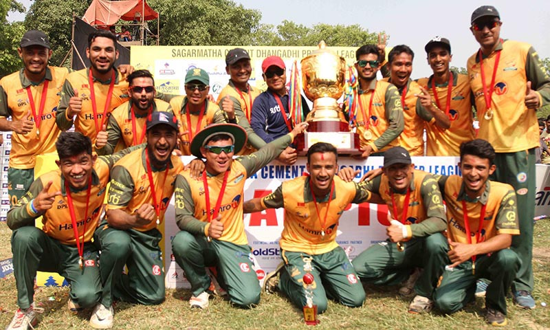 Players Chauraha Dhangadhi team pose for group photo after winning trophy and cash prize during the prize distribution ceremony of Dhangadhi Premier League cricket tournament at Dhangadhi SSP Cricket Ground in Kailali district on Saturday, April 22, 2017. Photo: Udipt Singh Chhetry/THT