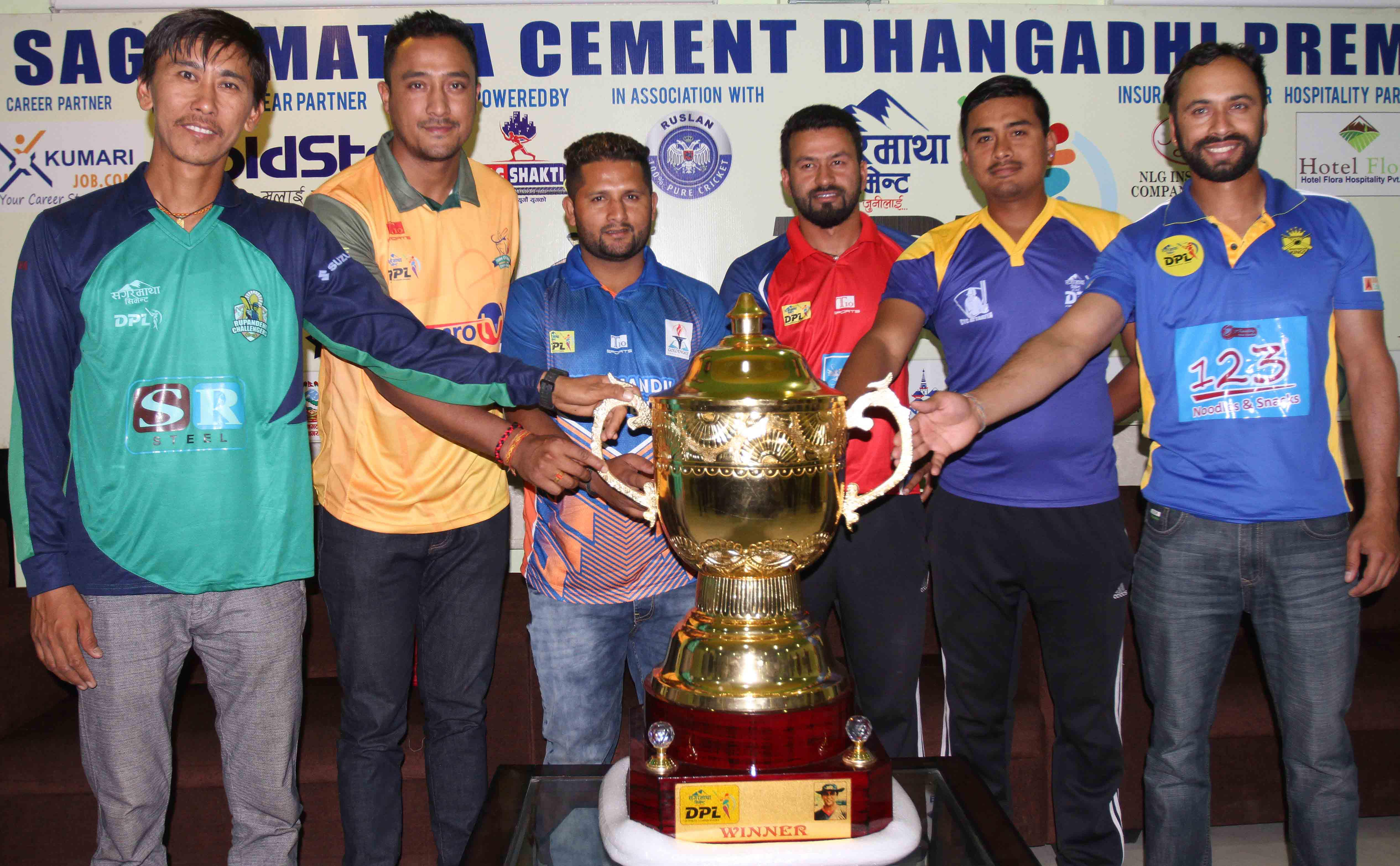 From left skippers Shakti Prasad Gauchan, Paras Khadka, Basanta Regmi, Binod Bhandari, Gyanenedra Malla and Sharad Vesawkar pose for group photo  after unveiling winner's trophy during pre-match press meet of DPL Dhangadhi Premier League Cricket Tournament in Dhangadhi, Kailali district, on Saturday, April 8, 2017. Photo: Udipt Singh Chhetry/THT