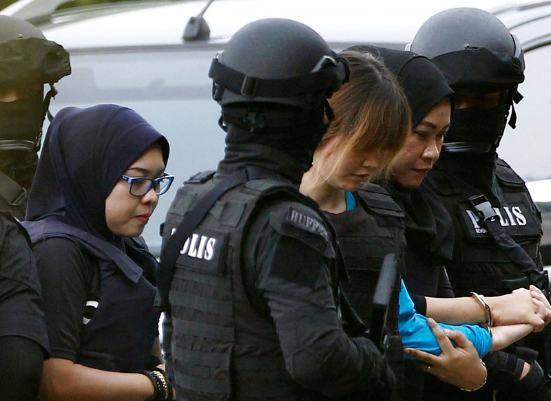 Vietnamese Doan Thi Huong, who is charged for the murder of Kim Jong Nam, is escorted by police as she arrives at a Sepang court, in Malaysia on April 13, 2017. Photo: Reuters