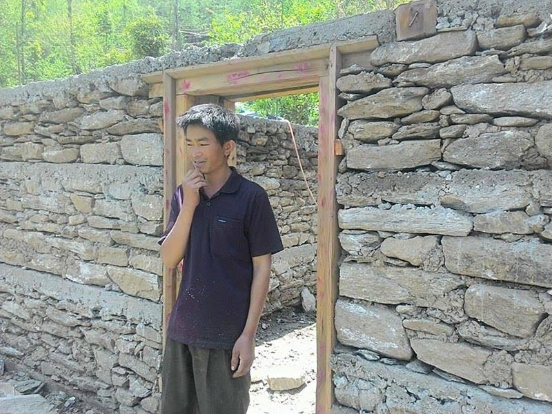 A quake victim who left his under-construction house incomplete as he was yet to receive the second instalment of reconstruction grant, in Dolakha, on Monday, april 17, 2017. Photo: THT