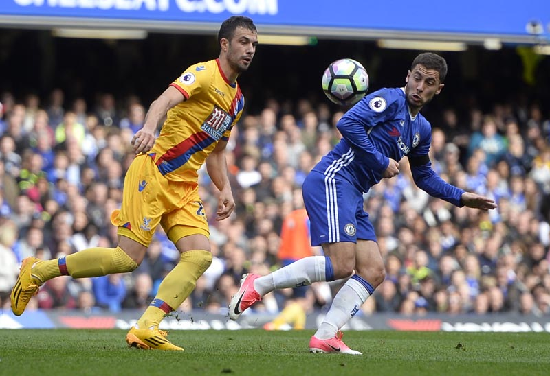 Chelsea's Eden Hazard in action with Crystal Palace's Luka Milivojevic. Photo: Reuters