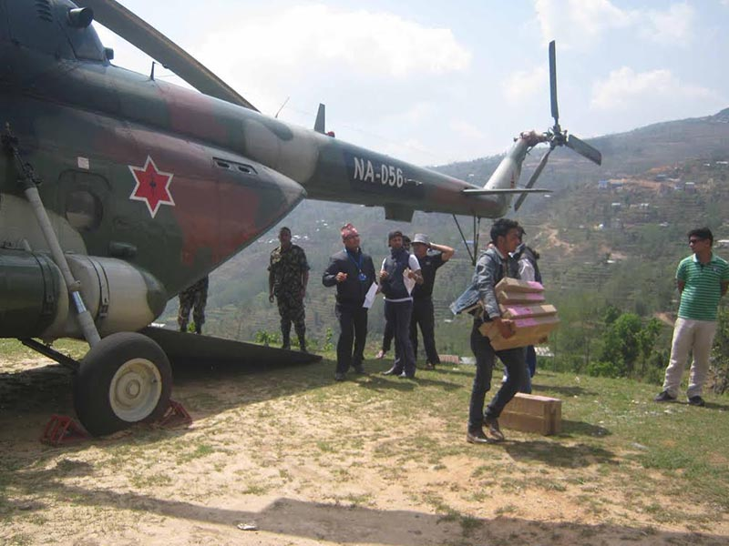 Security personnel and election officials receiving ballot papers for local level elections, which were nairlifted by a Nepali Army helicopter at Jayapuridanda, Diktel, in Khotang, on Tuesday, April 25, 2017. Photo: THT