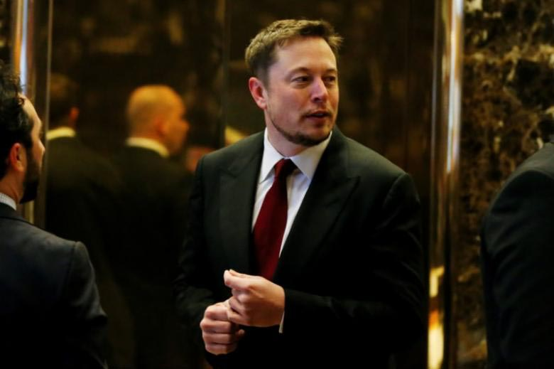 FILE PHOTO: Tesla Chief Executive, Elon Musk enters the lobby of Trump Tower in Manhattan, New York, US, January 6, 2017. Photo: Reuters