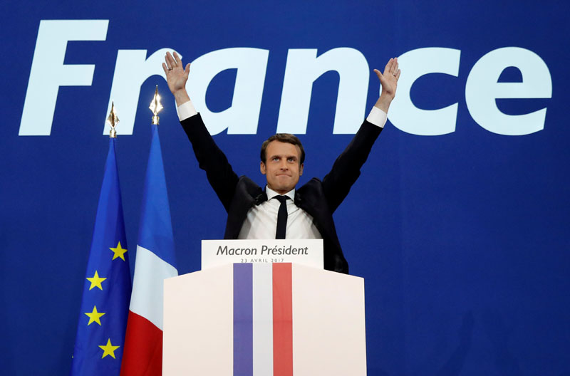 Emmanuel Macron, head of the political movement En Marche !, or Onwards !, and candidate for the 2017 French presidential election, celebrates after partial results in the first round of 2017 French presidential election, at the Parc des Expositions hall in Paris, France on April 23, 2017. Photo: Reuters