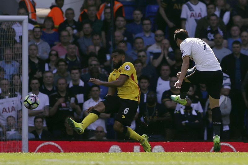 Tottenham's Son Heung-Min (right) scores a goal during the English Premier League soccer match between Tottenham Hotspur and Watford at White Hart Lane in London, on Saturday April 8, 2017. Photo: AP