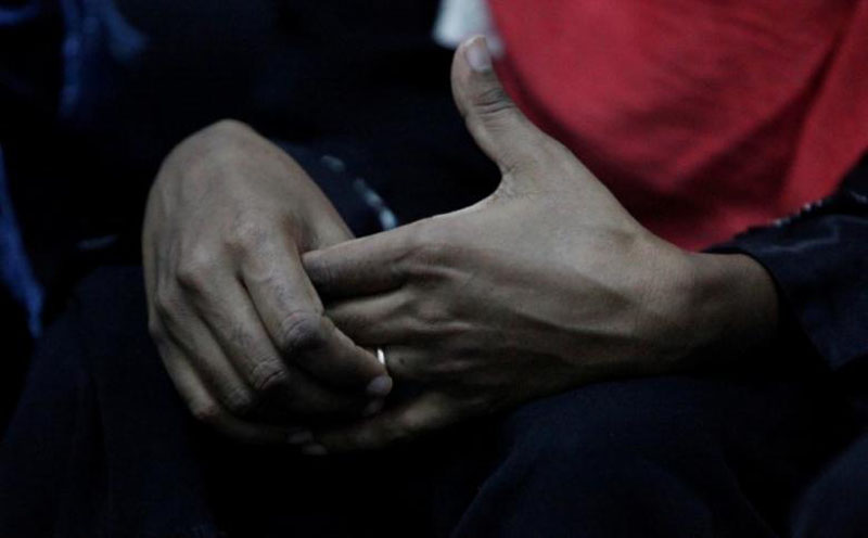 File - An Eritrean migrant touches a ring on her hand at a military building in Misrata, Libya, on November 6, 2016. Photo: Reuters