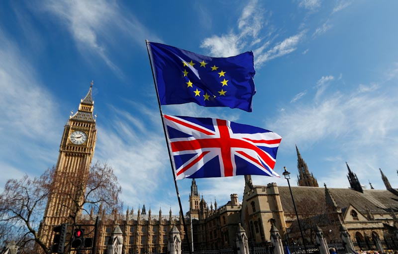 FILE - EU and Union flags fly above Parliament Square in London, Britain, on March 25, 2017. Photo: Reuters