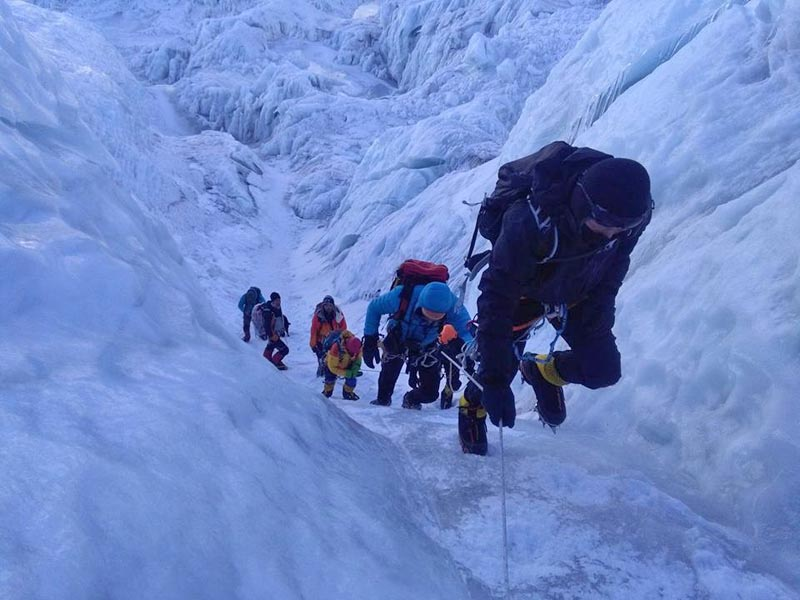 A Sherpa climber who was injured in avalanche being rescued on Mt Everest,