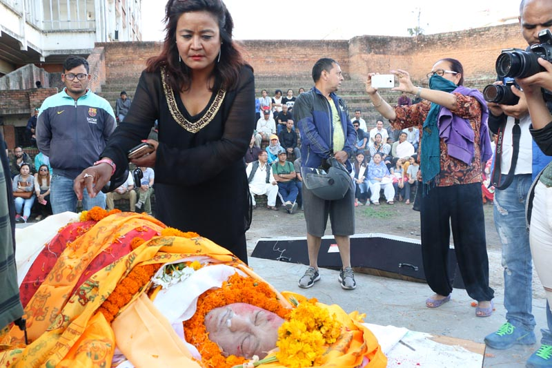 A woman pays final tribute to the late artist Pradeep Kumar Singh at the Nepal Academy in Kathmandu, on Monday, April 24, 2017. Photo: RSS