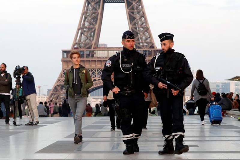 Police patrol at the Trocadero near the Eiffel Tower after a policeman was killed and two others were wounded in a shooting incident in Paris, France, on April 21, 2017. Photo: Reuters