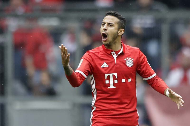 Bayern's Thiago celebrates after scoring his side's second goal during the German Bundesliga soccer match between FC Bayern Munich and FSV Mainz 05 at the Allianz Arena stadium in Munich, Germany, on Saturday, April 22, 2017. Photo: AP