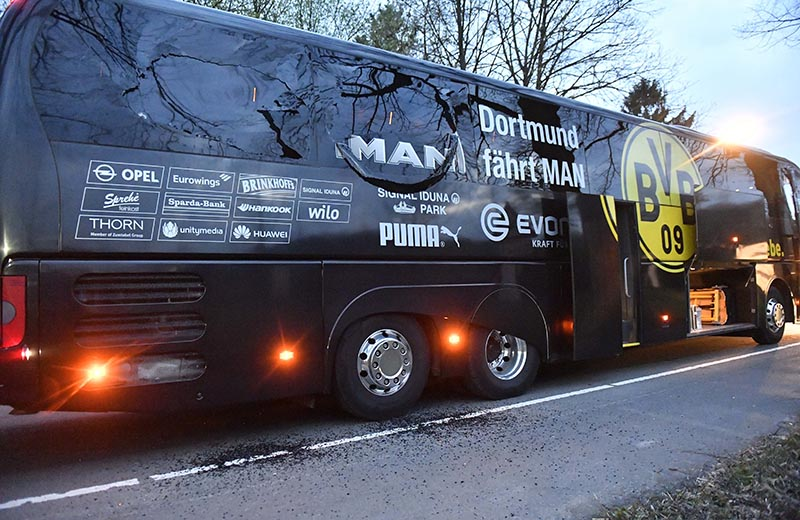 A window of Dortmund's team bus is damaged after an explosion before the Champions League quarterfinal soccer match between Borussia Dortmund and AS Monaco in Dortmund, western Germany, on Tuesday, April 11, 2017.  Photo: AP