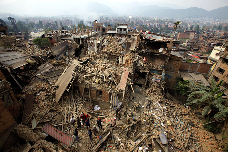 In this April 26, 2015, file photo, rescue workers remove debris as they search for victims of an earthquake in Bhaktapur near Kathmandu, Nepal. Photo: AP