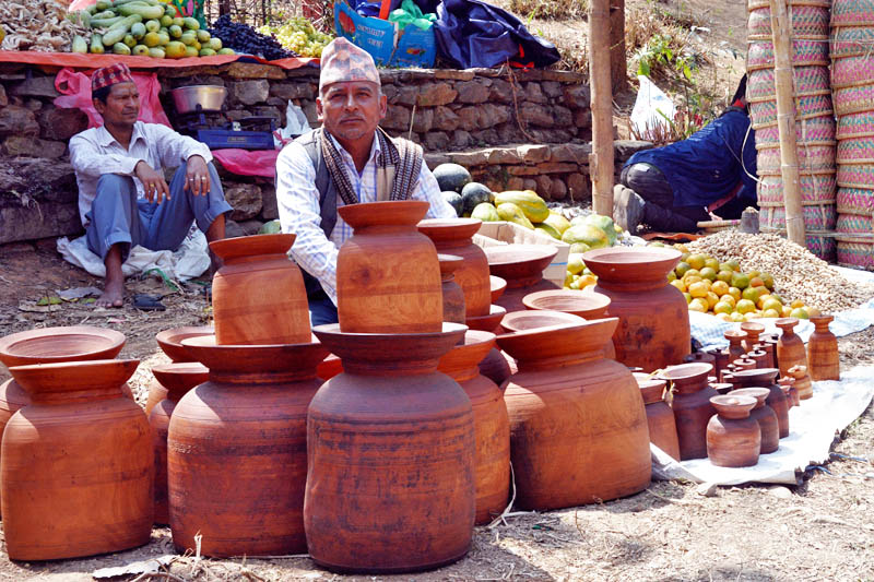 A vendor awaits customers to sell homemade traditional wooden crafts during the ongoing Chaitrashtami festival in Baglung on Monday, April 3, 2017. Photo: RSS