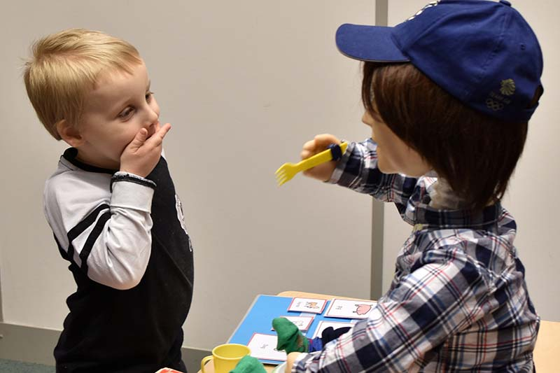 File-Harrison (5), who is autistic, plays with Kaspar, a child-sized humanoid robot developed at the University of Hertfordshire to interact and help improve the lives of children with autism, in Stevenage, Britain on January 30, 2017. Photo: Reuters