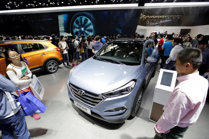 Visitors walk around the new Hyundai Tucson during Auto China 2016 auto show in Beijing, China, on May 4, 2016. Photo: Reuters/File