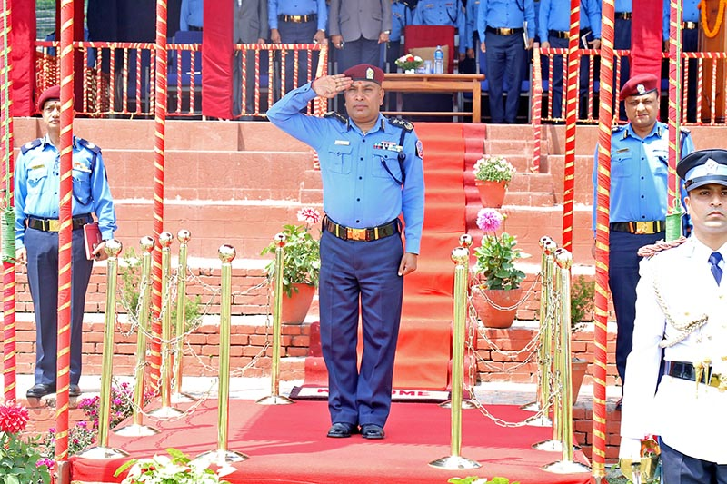 Newly appointed IGP of Nepal Police Prakash Aryal receives guard of honour at the police headquarters in Naxal, Kathmandu, on Tuesday, April 11, 2017. Photo: RSS
