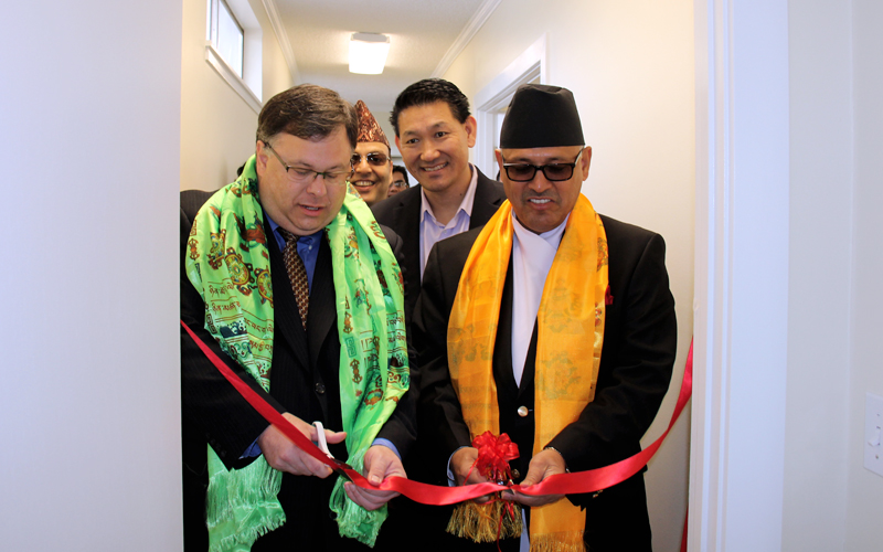 Ambassador of Nepal to the US Dr Arjun Karki (Right) and John Marcin, Mayor of City of Raymond, jointly inaugurate the Office of the Honorary Consul of Nepal for Seattle in the Washington State of the United States of America, on Sunday, April 30, 2016. Photo Courtesy: AC Sherpa
