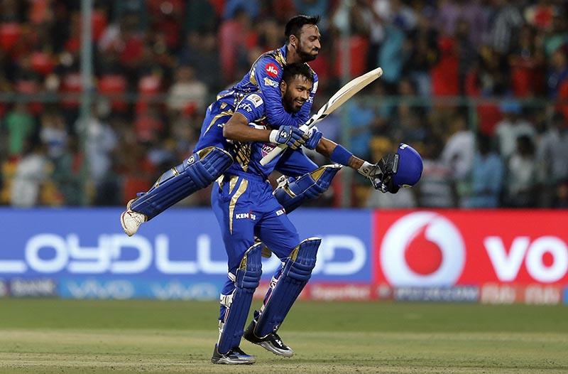 Mumbai Indians Krunal Pandya (left) and Hardik Pandya celebrate their win over Royal Challengers Bangalore in the Indian Premier League (IPL) cricket match in Bangalore, India, on Friday, April 14, 2017. Photo: AP