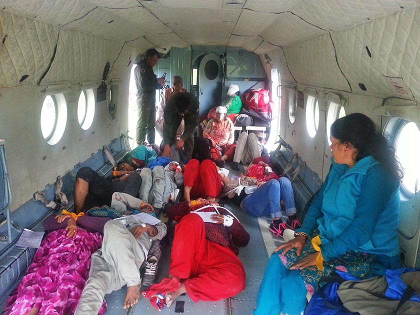 Pilgrims injured in bus accident at Kagbeni on a Nepal Army helicopter that airlifted them to Pokhara for treatment. Photo Courtesy: Sagar Raj Timilsina
