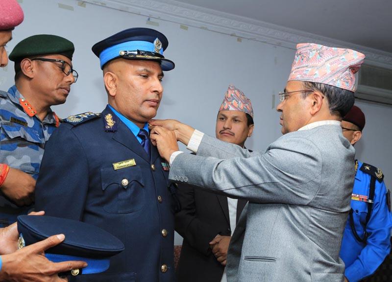 Home Secretary Lok Darshan Regmi confers IGP's insignia on Prakash Aryal. Photo: Nepal Police