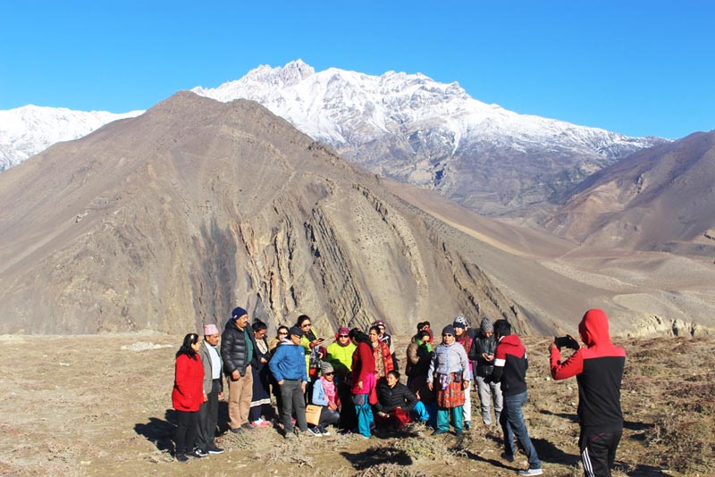 Tourists pose for a photo against the backdrop of snow-covered mountain in Mustang district, on Monday, April 10, 2017. Photo: RSS