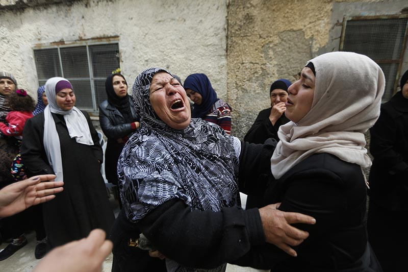 Women cry during the funeral of a 17-year old Palestinian Mahmoud Hattab at the Jalazoun refugee camp near the West Bank city of Ramallah, on Friday, March 24, 2017. Photo: AP