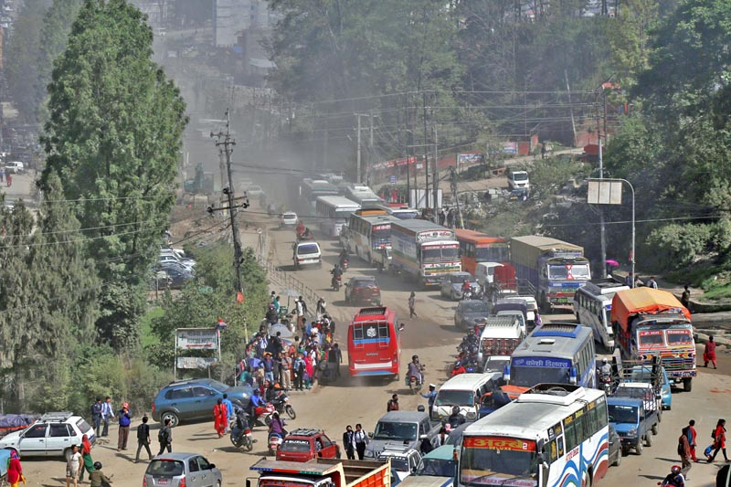 FILE - Vehicles seen plying amid smoke and dust,in Chabahill on Sunday, April 9, 2017. Photo: RSS