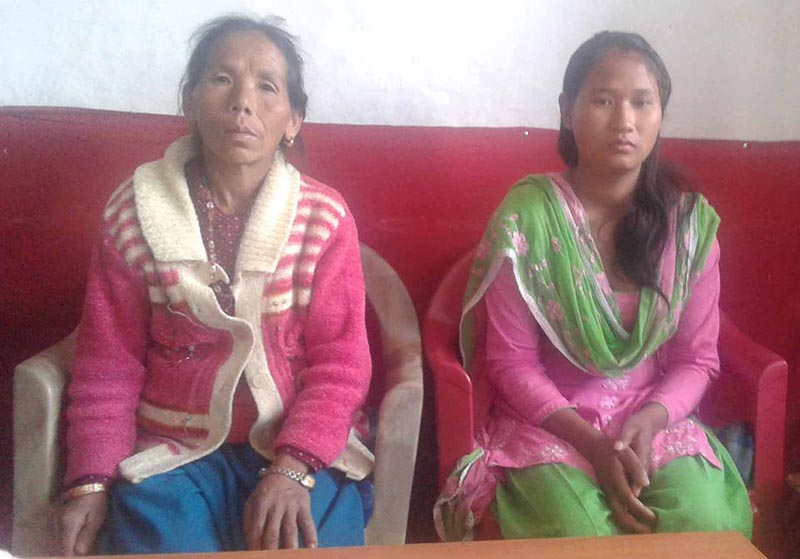Conflict victim Jamuna Rai (left) with her relative seeking the grant money at the Local Peace Committee, nKhotang, on Tuesday, April 25, 2017. Photo: THT