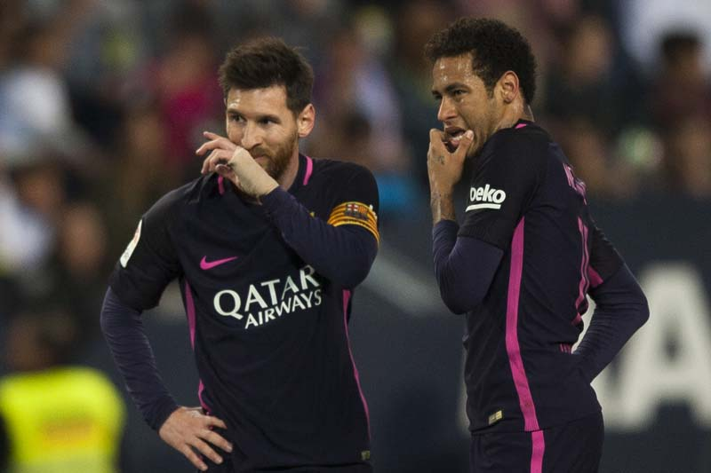 FC Barcelona's Lionel Messi and Neymar da Silva from Brazil gesture during their match against CF Malaga in a Spanish La Liga soccer match between Malaga and Barcelona in Malaga, Spain, on Saturday April 8, 2017. Photo: AP