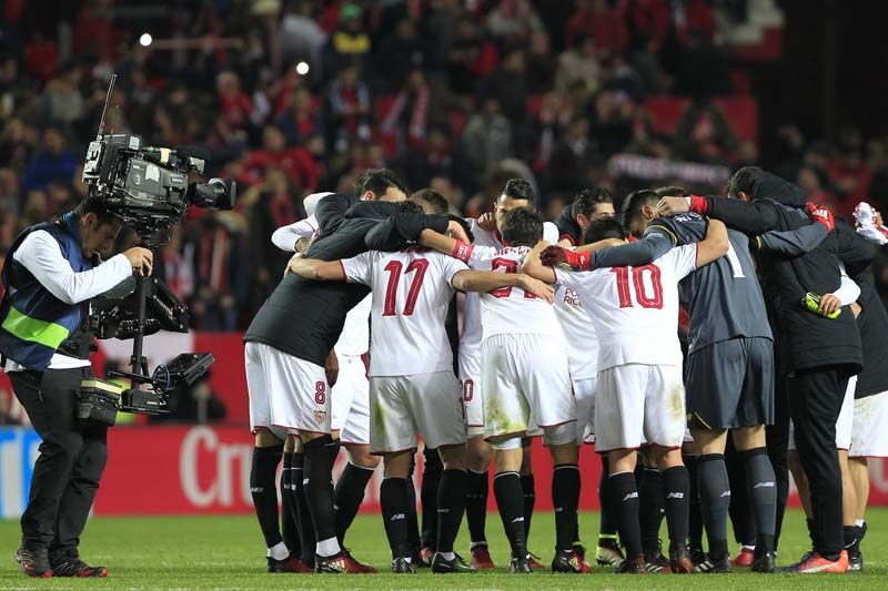 A TV camera operator films Sevilla players celebrating at the end of the match during La Liga soccer match against Real Madrid at the Ramon Sanchez Pizjuan stadium, in Seville, Spain, on January 15, 2017. Photo: AP/File