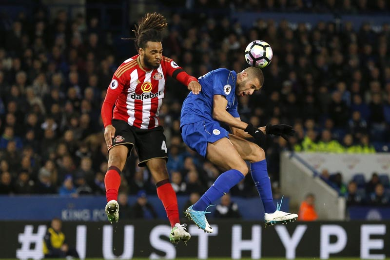 Leicester City's Islam Slimani in action with Sunderland's Jason Denayer. Photo: Reuters