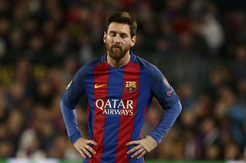 Barcelona's Lionel Messi reacts during the Champions League quarterfinal second leg soccer match between Barcelona and Juventus at Camp Nou stadium in Barcelona, Spain, on Wednesday, April 19, 2017. Photo: AP