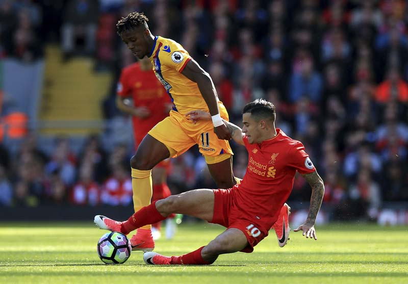 FILE:  Crystal Palace's Wilfried Zaha (left), and Liverpool's Philippe Coutinho battle for the ball during the English Premier League soccer match against Crystal Palace at Anfield, Liverpool, on Sunday April 23, 2017. Photo: AP