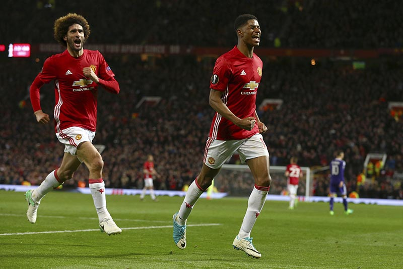 Manchester United's Marcus Rashford (right) celebrates scoring his side's second goal chased by his teammate Marouane Fellaini during the Europa League quarterfinal second leg soccer match between Manchester United and Anderlecht at Old Trafford stadium, in Manchester, England, on Thursday, April 20, 2017. Photo: AP