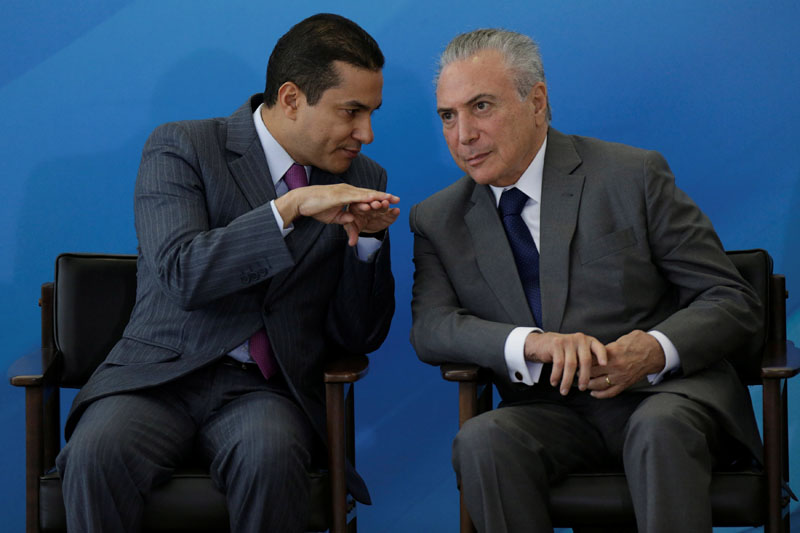 Brazil's Industry and Foreign Trade Minister Marcos Pereira speaks with Brazil's President Michel Temer during a ceremony at the Planalto Palace, in Brasilia, Brazil on April 12, 2017. Photo: Reuters