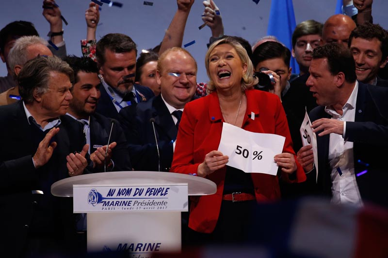 Marine Le Pen, French National Front (FN) political party leader and candidate for French 2017 presidential election, reacts a the end of her campaign rally in Paris, France, on April 17, 2017. Photo: Reuters