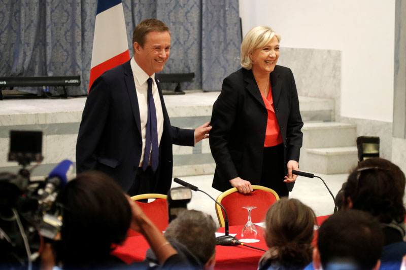 Marine Le Pen French National Front (FN) political party leader and candidate for French 2017 presidential election and Debout La France group former candidate Nicolas Dupont-Aignan attend a news conference in Paris, France, on April 29, 2017. Photo: Reuters